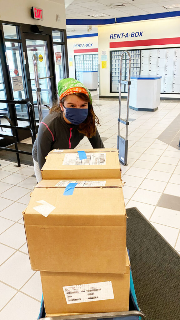 Celia bringing book 2 into the post office